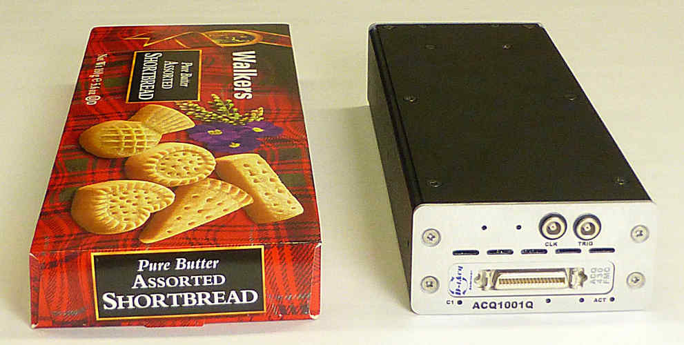 "ACQ1001 carrier + ACQ430FMC in 1U ""shortbread"" box, with a well-known brand of biscuit for scale."